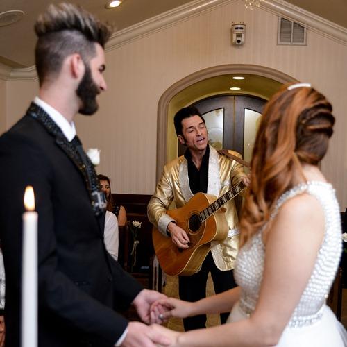 Elvis Serenades Couple at Chapel of the Flowers Wedding in Las Vegas