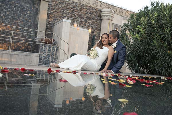 Wedding Photographer, Andreo and wife at Reflection Falls at Las Vegas Wedding Chapel of the Flowers