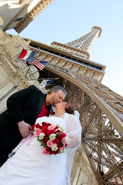 Las Vegas Strip Wedding Photo Session in front of Paris Las Vegas by Chapel of the Flowers