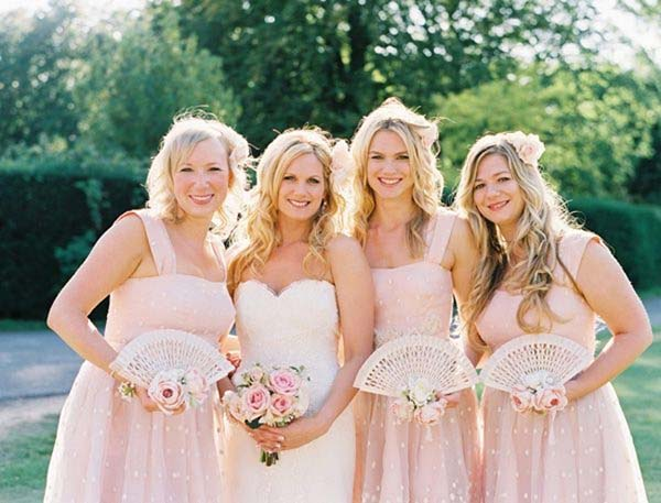 Summer Wedding Ideas to stay cool  Bride with Fan